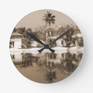View of cottages and lagoon water in Alleppey Round Wall Clocks