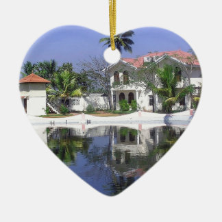 View of cottages and lagoon water in Alleppey Ornaments