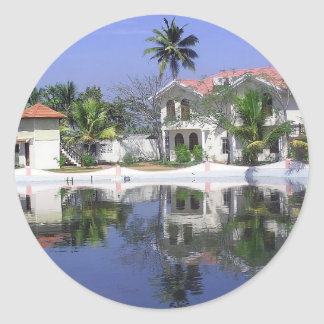 View of cottages and lagoon water in Alleppey Round Sticker