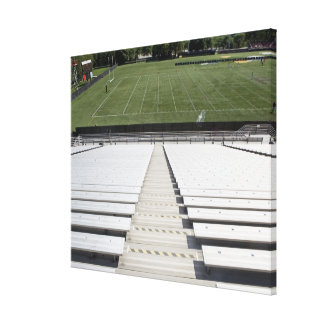 View of football field from empty bleachers canvas print