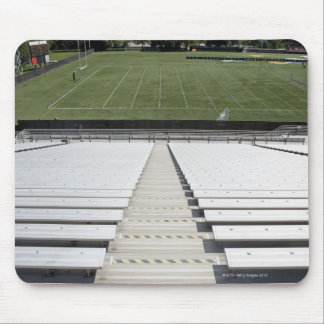 View of football field from empty bleachers mouse mat