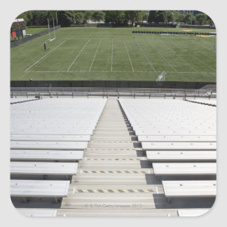 View of football field from empty bleachers square sticker