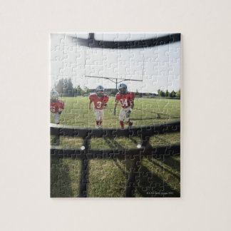 View of football players and field from inside jigsaw puzzle