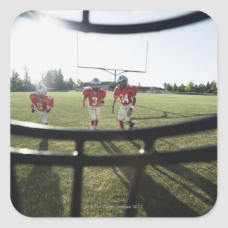 View of football players and field from inside square sticker