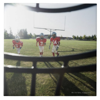 View of football players and field from inside tile