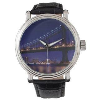 View of Manhattan bridge at night Watch