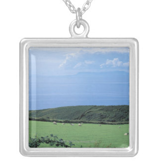 view of sheep grazing on lush hillside silver plated necklace