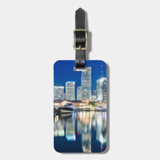 View of skyline with reflection in water, Miami Luggage Tag