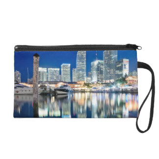 View of skyline with reflection in water, Miami Wristlet Clutches