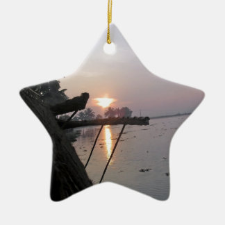 View of sunrise from a houseboat window christmas ornament