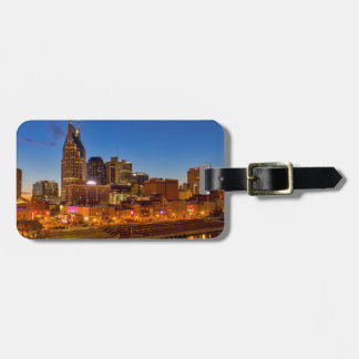 View of the city skyline at dusk luggage tag