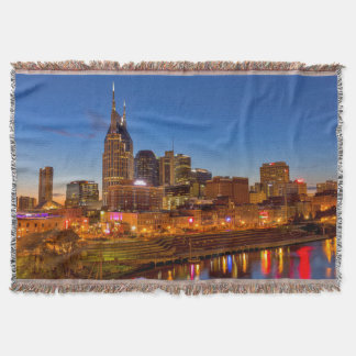View of the city skyline at dusk throw blanket
