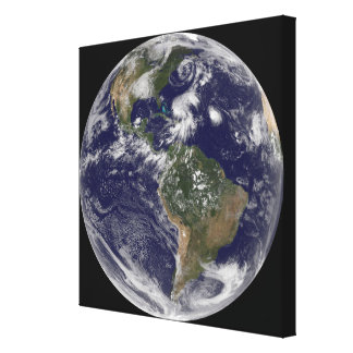 View of the full Earth and four storm systems Canvas Print