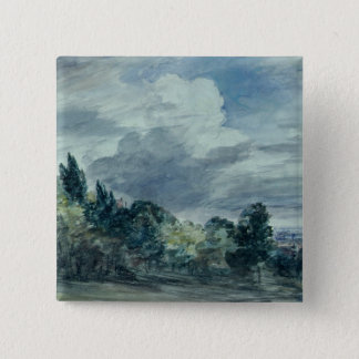 View over a wide landscape, with trees in the fore 15 cm square badge