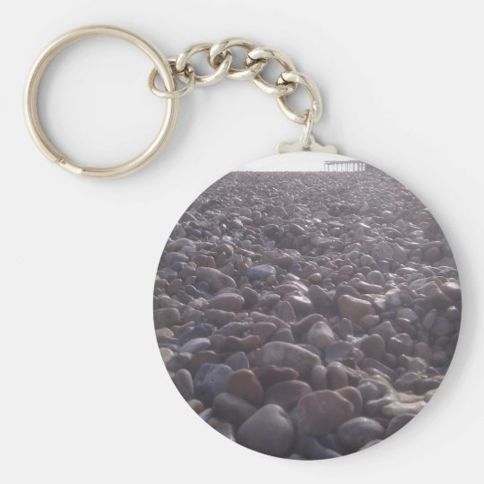 View over pebbles to silouetted West Pier Basic Round Button Key Ring