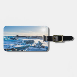 View over the frozen glacial lake luggage tag