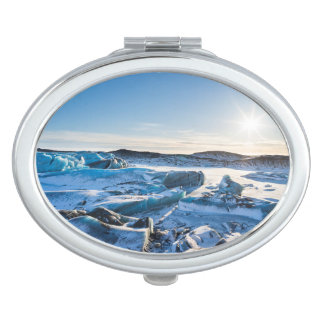 View over the frozen glacial lake travel mirror
