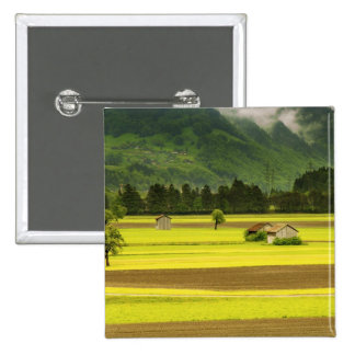 Views of orchards and fields under mountains 15 cm square badge