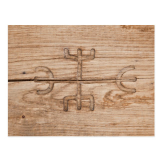 Viking rune on cracked wood postcard
