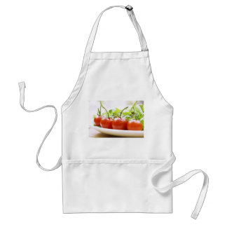 Vine tomatoes on a salad plate close up standard apron