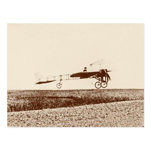 Vintage airplane taking off postcard