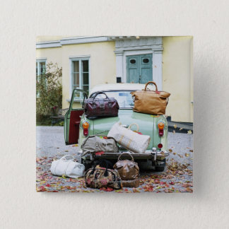 Vintage car with lots of luggage 15 cm square badge