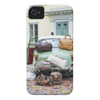 Vintage car with lots of luggage iPhone 4 cover