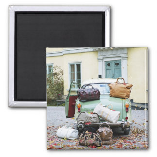 Vintage car with lots of luggage magnet