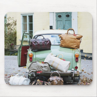 Vintage car with lots of luggage mouse mat