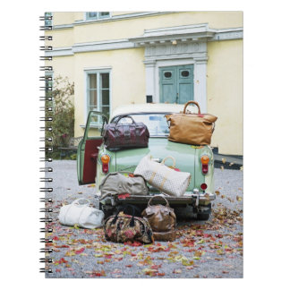 Vintage car with lots of luggage notebook