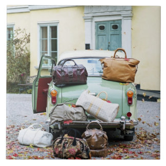 Vintage car with lots of luggage tile