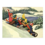 Vintage Christmas, Children Sledding on a Mountain Postcard