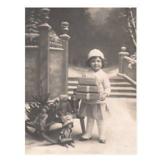 Vintage Christmas postcard-child with gifts