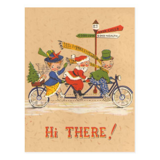 Vintage Christmas Santa Claus Riding a Bike Post Card
