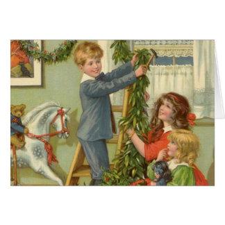 Vintage Christmas, Victorian Children Decorating Greeting Card