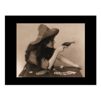 Vintage cowgirl with gun postcard