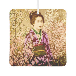 Vintage Geisha Posing in Cherry Blossoms
