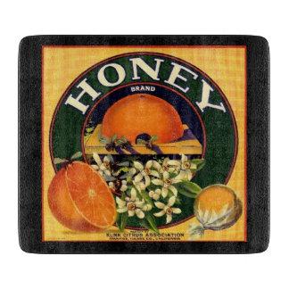 Vintage honey company advertisement cutting board