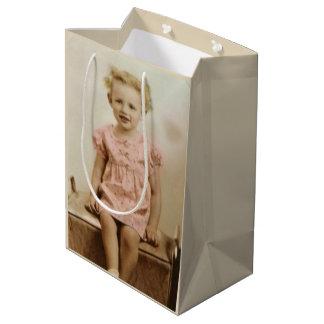 Vintage little blonde girl in pink dress gift bag