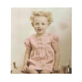 Vintage little blonde girl in pink dress notepad