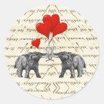 Vintage mammoths and hearts round sticker