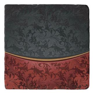 Vintage ornament red and black trivet
