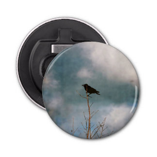 Vintage photograph of a crow on a tree bottle opener