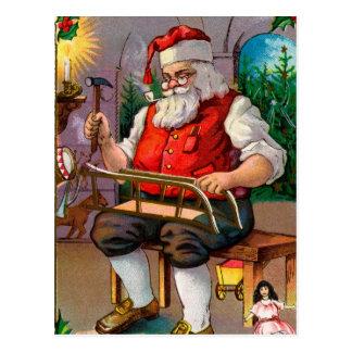 Vintage Santa Making Toys Postcard