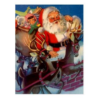 Vintage Santa & reindeer sleigh toys chimney Postcard