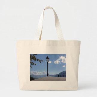 Vintage street lamp against blue sky jumbo tote bag