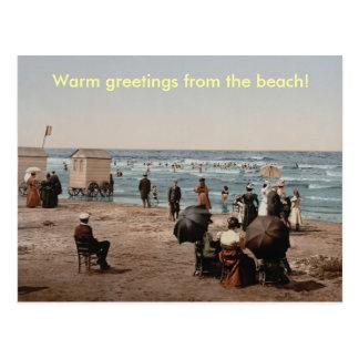 Vintage sun bathing people on the beach postcard