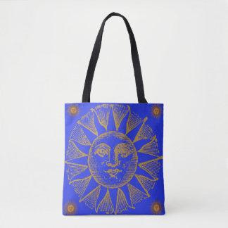 vintage sun on blue tote bag