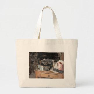 Vintage Type writer in dusty office workshop Large Tote Bag