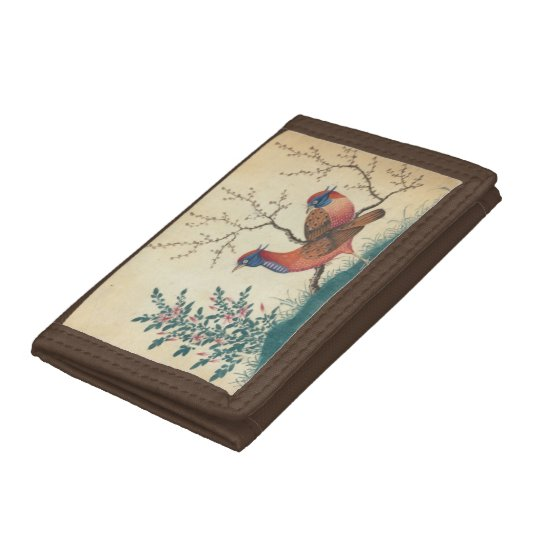 Vintage wallet with two pheasant birds with plants